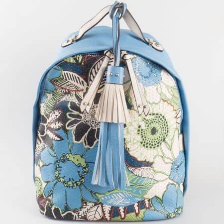 Дамска екстравагантна раничка с цветя и пискюл на френския производител David Jones в синьо и бяло ch5092-1s