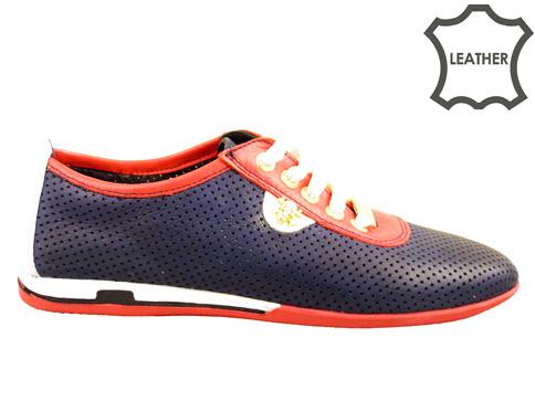 Модерни дамски обувки с комфортно гъвкаво ходило, изработени от перфорирана естествена кожа в син цвят n105s