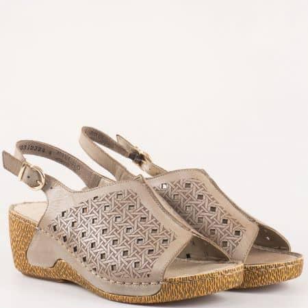 Дамски сандали на шито клин ходило- Rieker от перфорирана естествена кожа в кафяво, стелката също е естествена 65696k